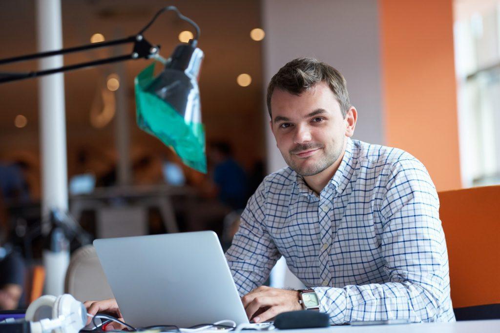 man at desk on laptop